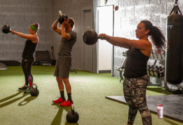 Dumbell exercise in a TRIBE Team Training class at Gravity Fitness and Training
